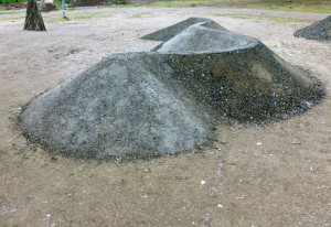 a temporary land art project figures in the park, parco della sacine in florence italy 2015, materials are stones, branches, grass, stabilized sand, cross-section is 12 meters, 3