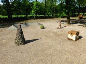 a temporary land art project figures in the park, parco della sacine in florence italy 2015, materials are stones, branches, grass, stabilized sand, cross-section is 12 meters. 2