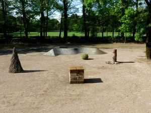 a temporary land art project figures in the park, parco della sacine in florence italy 2015 , materials are stones, branches, grass, stabilized sand, cross-section is 12 meters. 1